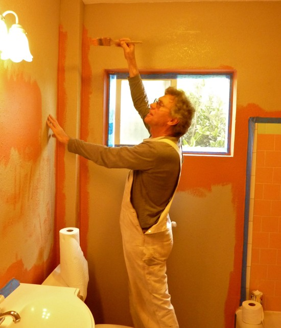 My friend and fellow cook in Palo Alto came up to help with painting and handyman chores. Here he cooks in terra cotta pink paint in the bathroom.  The color is partly inspired by the pink tiles which surround the bath tub which appear to be old, and may be original to the house.